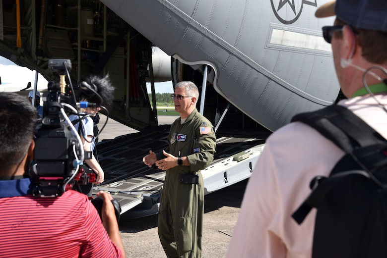 Lt. Col. Jeff Ragusa, 53rd Weather Reconnaissance Squadron chief pilot, explains the capabilities of the WC-130J Super Hercules during a media tour of the aircraft May 10, 2019, in Brunswick, Georgia. Media tours were given during the Hurricane Awareness Tour to help create a weather-ready nation by raising awareness for the upcoming hurricane season occurring June 1-Nov. 30, with emphasis this year on raising awareness about inland flooding. (U.S. Air Force photo by Tech. Sgt. Christopher Carranza)