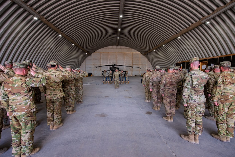 Members from the 35th Combat Aviation Brigade, Missouri Army National Guard, and the 244th Expeditionary Combat Aviation Brigade, U.S. Army Reserve, salute the colors during a transfer of authority ceremony in an aircraft hangar in Taji, Iraq, May 1, 2019.  The 35th CAB and 244th ECAB support Combined Joint Task Force – Operation Inherent Resolve and Operation Spartan Shield.  CJTF-OIR works with partner forces to defeat Daesh in designated areas and set conditions for follow-on operations to increase regional stability.