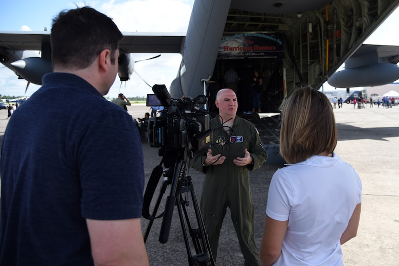 Maj. Tobi Baker, 53rd Weather Reconnaissance Squadron aerial reconnaissance weather officer, talks about his duties and responsibilities as an ARWO during an interview May 10, 2019, in Brunswick, Georgia. Media interviews were conducted during the Hurricane Awareness Tour to help create a weather-ready nation by raising awareness for the upcoming hurricane season occurring June 1-Nov. 30, with emphasis this year on raising awareness about inland flooding. (U.S. Air Force photo by Tech. Sgt. Christopher Carranza)