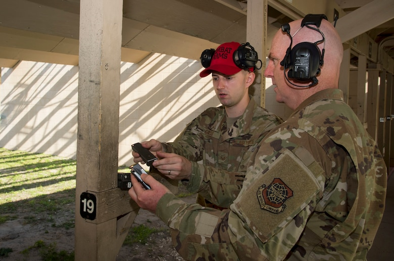 U.S. Air Force (USAF) Maj. Gen. Sam Barrett, the 18th Air Force commander from Scott Air Force Base, Ill., prepares M-9 pistol magazines with USAF Staff Sgt. Dalhian Guest, a 6th Security Forces Squadron combat arms instructor, at MacDill AFB, Fla., May 9, 2019.