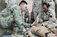 Spc. Jay Choi, left, a medic with the 64th Brigade Support Battalion, 3rd Armored Brigade Combat Team, 4th Infantry Division, Task Force Spartan, works with soldiers from the Kuwaiti Land Forces 11th Engineer Battalion to conduct medical training at Camp Buehring, Kuwait, on April 3, 2019. Choi said he enjoyed working with the KLF Soldiers on developing basic combat lifesaver skills and getting the opportunity to see how other forces are trained.