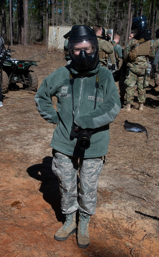 U.S. Air Force Airman 1st Class Kaitlyn Brewer stands with a gas mask for 20th Security Forces Squadron training in Sumter, S.C., March 6, 2019.