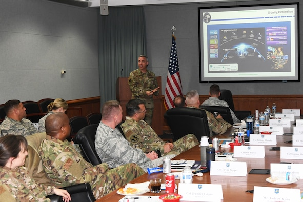 """Maj. Gen. Stephen Whiting, 14th Air Force commander, speaks to wing commanders and leaders during a commander's conference at Peterson Air Force Base, May 7, 2019. During the conference Whiting delivered guidance associated with the 14th Air Force strategic plan, key initiatives, and organizational changes designed to support the future standup of U.S. Space Command. During the conference Lt. Gen. (ret) Glen """"Wally"""" Moorhead, Department of Defense space mentor, and former 50th Space Wing commander, also met with the space commanders to reflect on how they can lead through change, and prepare for a war in space. (U.S. Air Force photo by Maj. Cody Chiles)"""