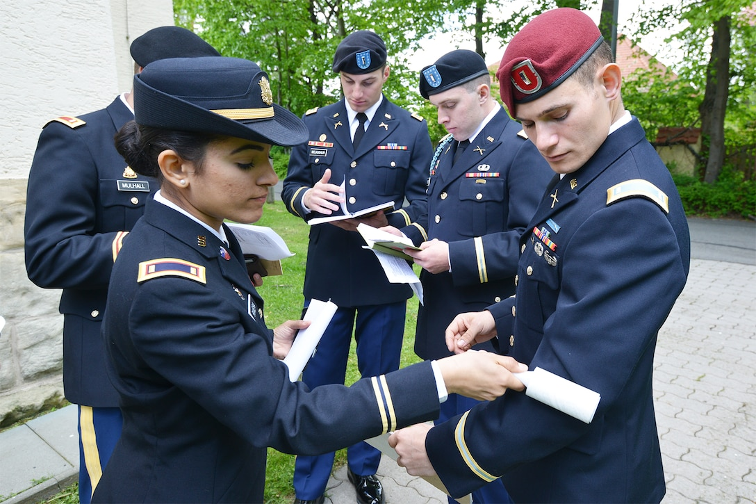 Soldiers prepare for a competition in uniform.