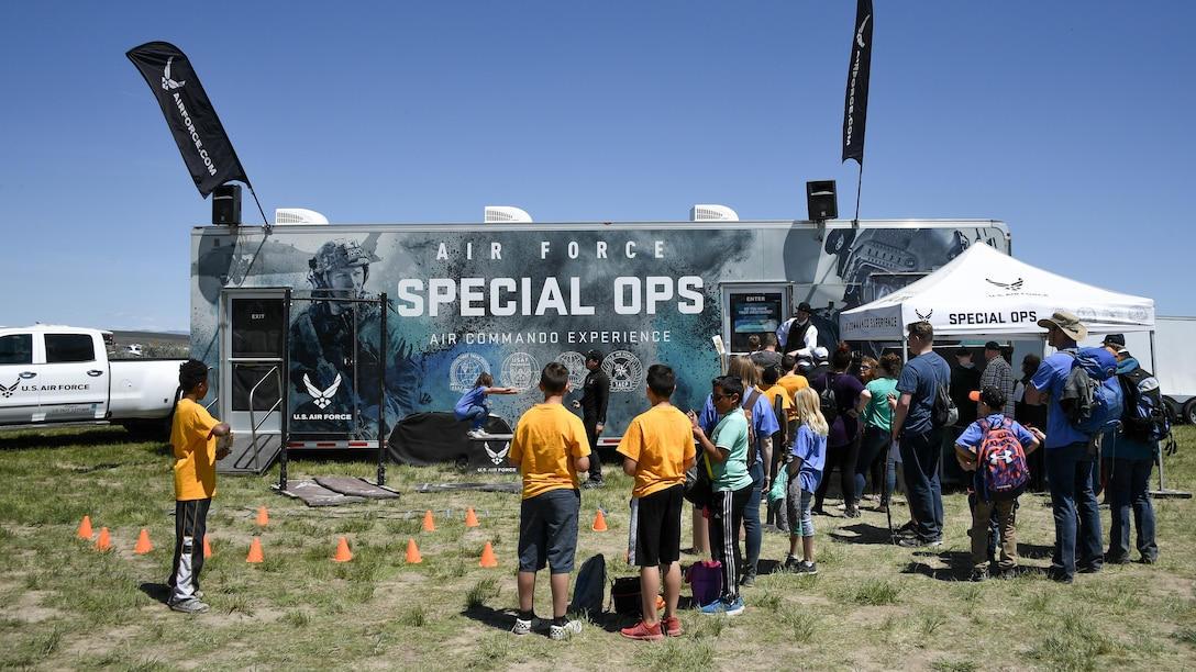"""The Air Force Special Ops """"Air Commando Experience"""" exhibit during the Golden Spike Sesquicentennial Celebration May 10, 2019, at Promontory Summit, Utah. The celebration was supported by Air Force Recruiting Service and the Hill Air Force Base STEM Outreach program. (U.S. Air Force photo by R. Nial Bradshaw)"""