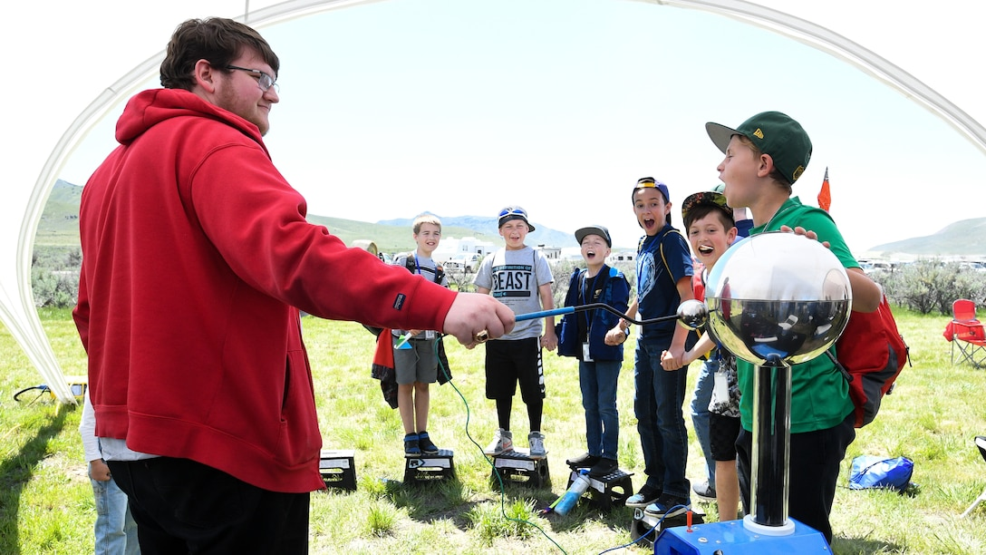 """Lance Gerday demonstrates an electrostatic generator during the Golden Spike Sesquicentennial Celebration May 10, 2019, at Promontory Summit, Utah. Event festivities included an """"Innovation Summit"""" that focused on STEM-related activities hosted by Hill Air Force Base, industry, and secondary and higher education. (U.S. Air Force photo by R. Nial Bradshaw)"""
