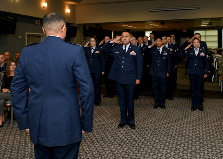 U.S. Air Force Lt. Col. David Sarabia, outgoing 313th Training Squadron commander, receives a final salute from the personnel of the 313th Training Squadron during a change-of-command ceremony at the event center on Goodfellow Air Force Base, Texas, May 10, 2019. In October of 2018, the need for advanced Intelligence, Surveillance, and Reconnaissance training resulted in the reactivation of the 313th TRS under Sarabia. (U.S. Air Force photo by Airman 1st Class Robyn Hunsinger/released)