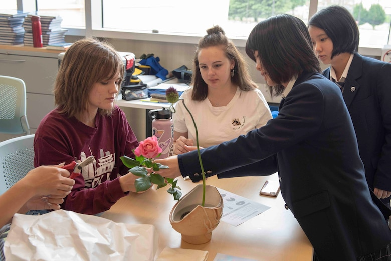 Students from Ome Sogo High School show students from Yokota High School how to properly arrange an Ikebana Floral arrangement during the National Asian American and Pacific Islander Heritage Celebration at Yokota High School, Yokota Air Base, Japan, May 6, 2019.