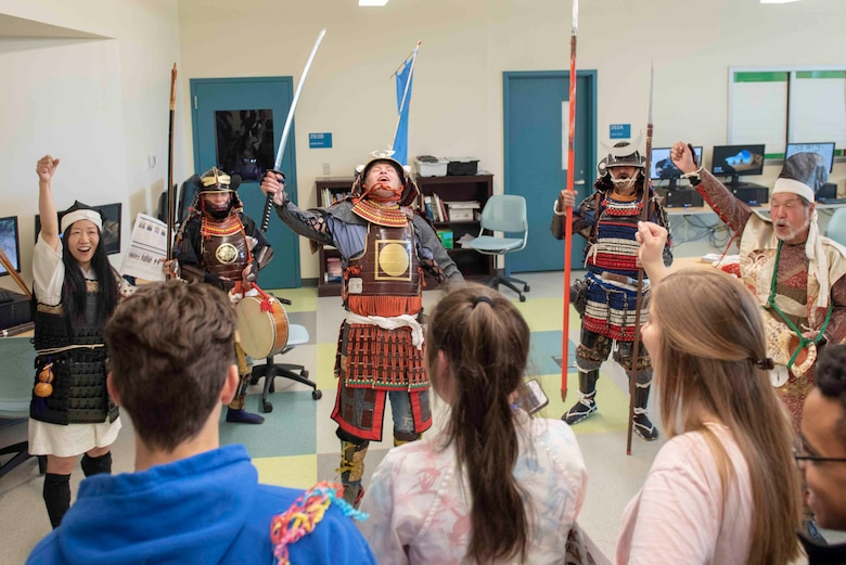 A Yokota High School student in traditional samurai armor leads a victory cheer during the National Asian American and Pacific Islander Heritage Celebration at Yokota High School, Yokota Air Base, Japan, May 6, 2019.