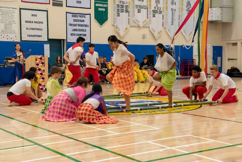 Students perform the Tinikling, a traditional Philippine folk dance, during the National Asian American and Pacific Islander Heritage Celebration at Yokota High School, Yokota Air Base, Japan, May 6, 2019.