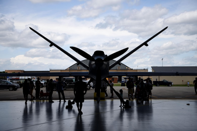 Spectators check out the MQ-9 Reaper during the Joint Base Andrews 2019 Air and Space Expo at Joint Base Andrews, Maryland, May 10, 2019. The MQ-9 Reaper was a static display at this year's show celebrating legends in flight. (U.S. Air Force photo by Airman 1st Class Haley Stevens)