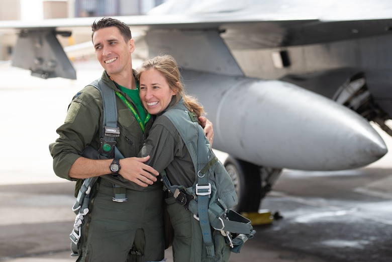 Capt. Kyle Moses, 310th Fighter Squadron instructor pilot, receives a hug from his sister Capt. Kaleigh Moses, 56th Medical Operations Squadron nurse practitioner, before flying in the backseat of an F-16D Fighting Falcon at Luke Air Force Base, Ariz., May 10, 2019. Kaleigh flew alongside her sibling during a familiarization flight where she not only saw what her brother does as an instructor pilot, but was able to see how her job facilitates the training. (U.S. Air Force photo by Staff Sgt. Jensen Stidham)