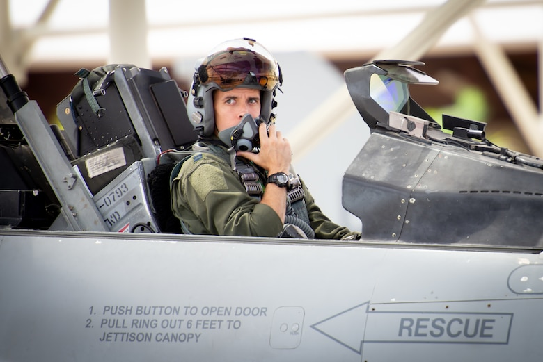 Capt. Kyle Moses, 310th Fighter Squadron instructor pilot, waits in the cockpit of an F-16D Fighting Falcon at Luke Air Force Base, Ariz., May 10, 2019. Moses flew alongside his sister Capt. Kaleigh Moses, 56th Medical Operations Squadron nurse practitioner, who sat in the backseat of his wingman's jet during a familiarization flight. (U.S. Air Force photo by Staff Sgt. Jensen Stidham)