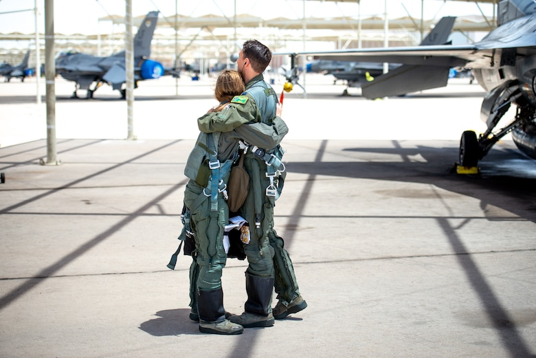 Capt. Kaleigh Moses (left), 56th Medical Operations Squadron nurse practitioner, hugs her brother Capt. Kyle Moses, 310th Fighter Squadron instructor pilot, before flying in the backseat of an F-16D Fighting Falcon at Luke Air Force Base, Ariz., May 10, 2019. Kaleigh flew alongside her sibling during a familiarization flight where she not only saw what her brother does as an instructor pilot, but was able to see how her job facilitates the training. (U.S. Air Force photo by Staff Sgt. Jensen Stidham)