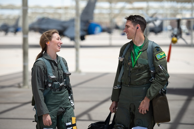 Capt. Kaleigh Moses (left), 56th Medical Operations Squadron nurse practitioner, smiles at her brother Capt. Kyle Moses, 310th Fighter Squadron instructor pilot, after a flight in an F-16D Fighting Falcon at Luke Air Force Base, Ariz., May 10, 2019. Kaleigh flew alongside her sibling during a flight to help her understand how the contributions she makes as a nurse practitioner directly affects the pilots who teach and train the world's greatest fighter pilots. (U.S. Air Force photo by Staff Sgt. Jensen Stidham)