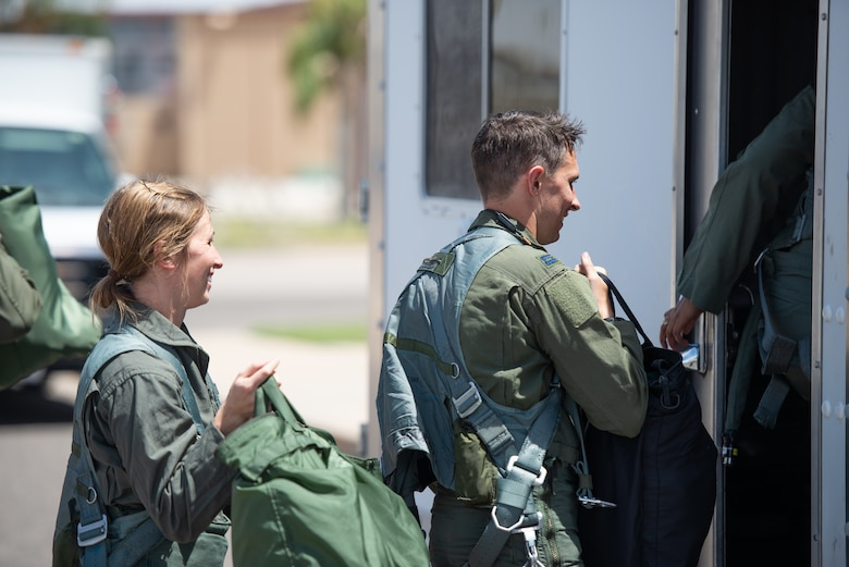 Capt. Kaleigh Moses (left), 56th Medical Operations Squadron nurse practitioner, follows her brother Capt. Kyle Moses, 310th Fighter Squadron instructor pilot, onto vehicle at Luke Air Force Base, Ariz., May 10, 2019. Kaleigh flew alongside her sibling during a flight in an F-16D Fighting Falcon to help her understand how the contributions she makes as a nurse practitioner directly affects the pilots who teach and train the world's greatest fighter pilots. (U.S. Air Force photo by Staff Sgt. Jensen Stidham)