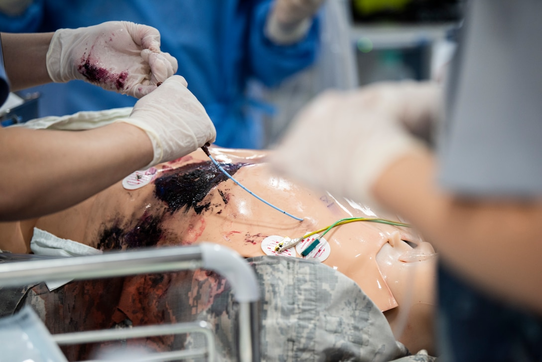 Medical staff perform surgery on a simulated patient at Wonkwang University Medical Center, Republic of Korea, May 8, 2019. The 8th Medical Group coordinated with Wonkwang to exercise emergency medical flight transport procedures and transfer a simulated patient from Kunsan Air Base to the hospital in Iksan. (U.S. Air Force photo by Senior Airman Stefan Alvarez)