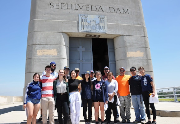 About a dozen University of California, Los Angeles, students pose for a picture with U.S. Army Corps of Engineers Los Angeles District employees April 25, following a tour of Sepulveda Dam Spillway in Los Angeles. The students learned about the dam's operations, hydrology and design, as well as information about careers with the Corps.
