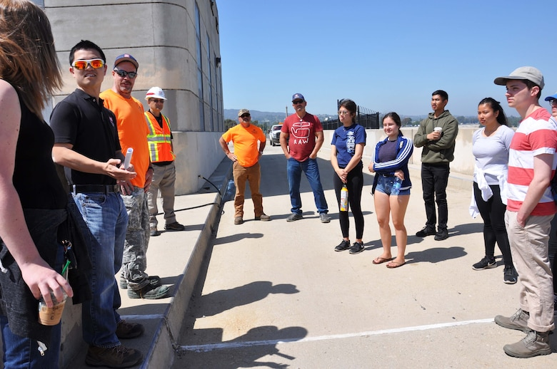 Reuben Sasaki, hydraulic engineer, Hydrology and Hydraulics Branch, Engineering Division, U.S. Army Corps of Engineers Los Angeles District, second from left, talks about the hydrology of the Sepulveda Dam with about a dozen University of California, Los Angeles students during an April 25 tour of the dam's spillway in Los Angeles.