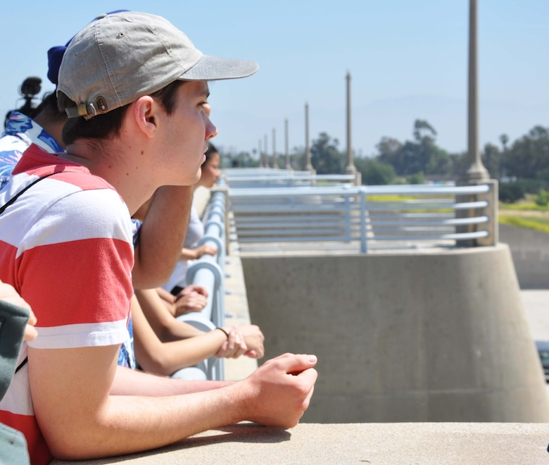 An engineering student with the University of California, Los Angeles looks out over the Sepulveda Dam Spillway April 25 in Los Angeles. The students took a tour of the outside and inside of the spillway to learn about the dam's operations, hydrology and design.