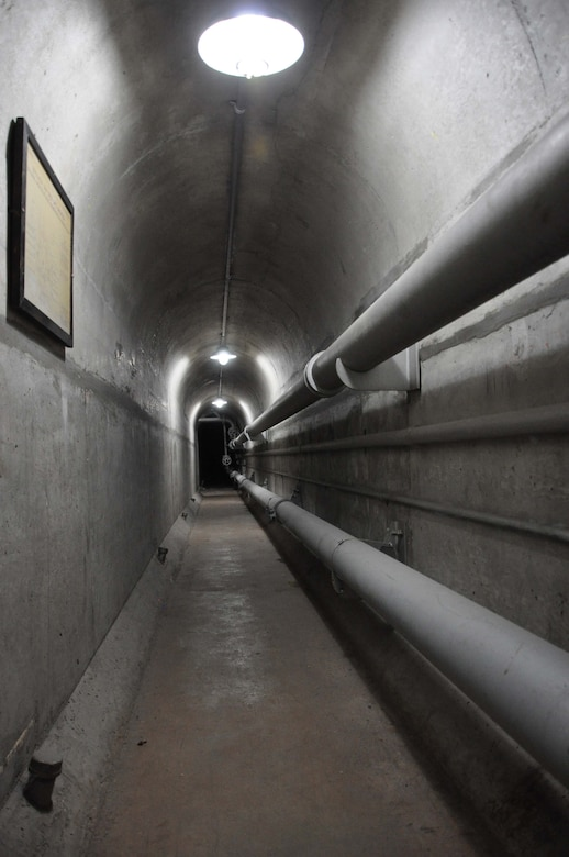 The tunnel underneath the Sepulveda Dam Spillway in Los Angeles extends the entire length of the spillway and part of the road leading from the spillway. Built in 1941, the purpose of Sepulveda Dam is to collect flood runoff from drainage areas upstream, store it temporarily and release it into the Los Angeles River at a rate of about 17,000 cubic feet per second.