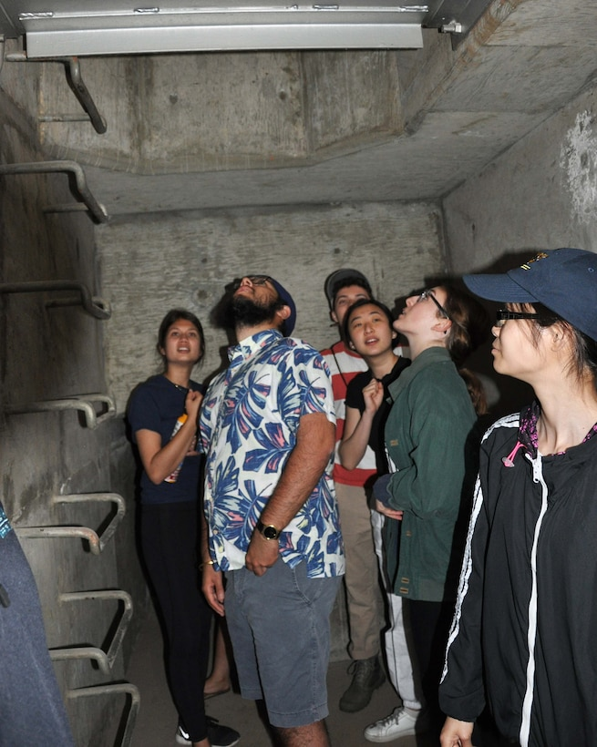 About a dozen University of California, Los Angeles, tour the inside of the Sepulveda Dam Spillway April 25 in Los Angeles. The students learned about the dam's operations, hydrology and design.