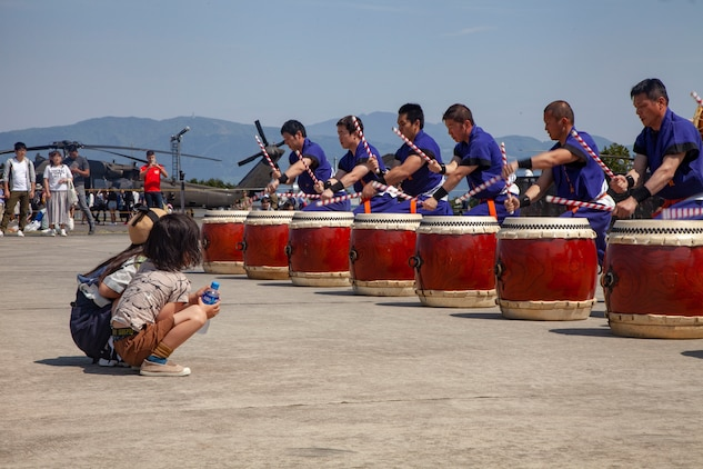 Children watch the Takigahara Taiko Drummers play for the Friendship Festival May 11, 2019, on Combined Arms Training Center Camp Fuji, Shizuoka, Japan.