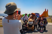 Local community members gather for a photo with the mascots during the Friendship Festival May 11, 2019, on Combined Arms Training Center Camp Fuji, Shizuoka, Japan.