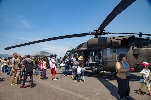 Festival attendees tour a Japan Ground Self-Defense Force UH-60 Blackhawk helicopter static display during the Friendship Festival May 11, 2019, on Combined Arms Training Center Camp Fuji, Shizuoka, Japan.