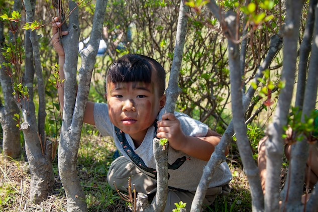 Children play in the bushes during the Friendship Festival May 11, 2019, on Combined Arms Training Center Camp Fuji, Shizuoka, Japan.