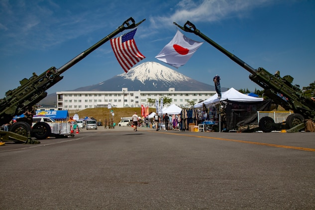 The Japan and U.S. flags hang on display from M777A2 lightweight 155 mm howitzers during the Friendship Festival May 11, 2019, on Combined Arms Training Center Camp Fuji, Shizuoka, Japan.