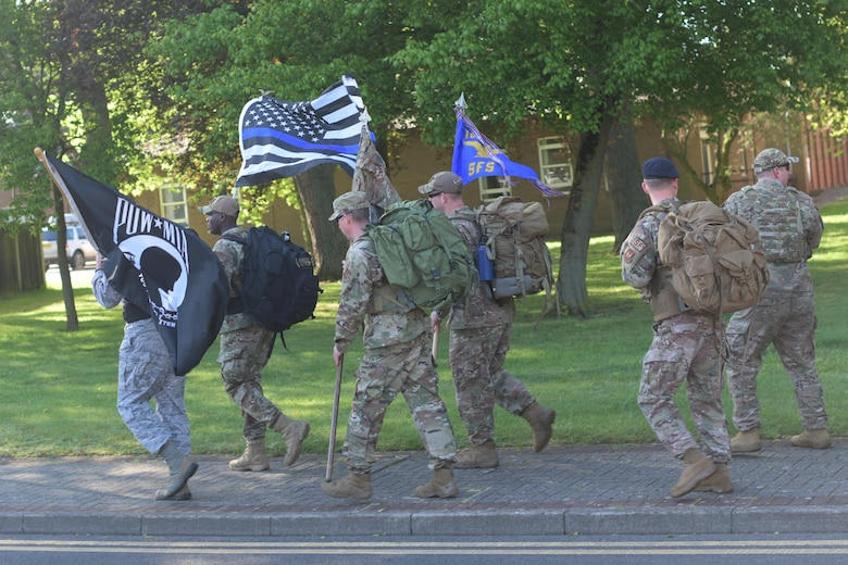 Members of the 100th and 48th Security Forces Squadrons participate in a ruck march at RAF Mildenhall, England, May 13, 2019. The week of May 15, is designated National Police Week and honors fallen law enforcement officers. (U.S. Air Force photo by Senior Airman Benjamin Cooper)