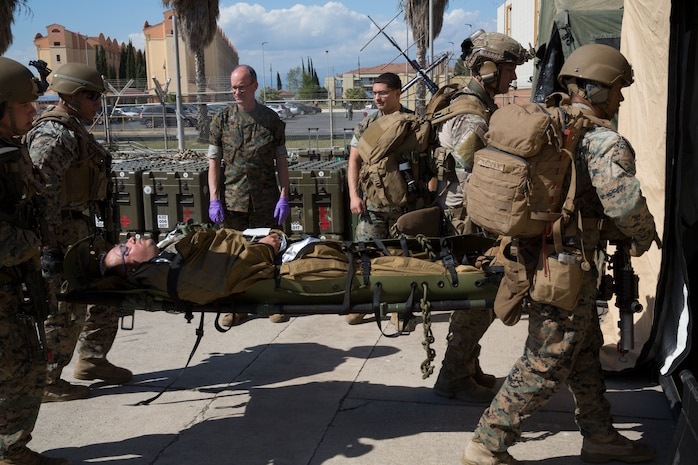 U.S. Marines with the Special Purpose Marine Air-Ground Task Force-Crisis Response-Africa 19.2, Marine Forces Europe and Africa,  transport a simulated casualty into a field-medical facility during a full-mission profile rehearsal at Naval Air Station Sigonella, Italy, May 2, 2019. SPMAGTF-CR-AF 19.2 conducted a full-mission profile rehearsal to increase proficiency and decrease crisis-response time for contingencies. SPMAGTF-CR-AF is deployed to conduct crisis-response and theater-security operations in Africa and promote regional stability by conducting military-to-military training exercises throughout Europe and Africa. (U.S. Marine Corps photo by Staff Sgt. Mark E Morrow Jr.)