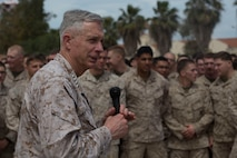 U.S. Marine Corps General Thomas D. Waldhauser, commander, U.S. Africa Command, addresses Marines and Sailors with the Special Purpose Marine Air-Ground Task Force-Crisis Response-Africa 19.2, Marine Forces Europe and Africa, at Naval Air Station Sigonella, Italy, May 9, 2019. General Waldhauser took time to speak with the SPMAGTAF about their and mission and role as a crisis response force. SPMAGTF-CR-AF is deployed to conduct crisis-response and theater-security operations in Africa and promote regional stability by conducting military-to-military training exercises throughout Europe and Africa. (U.S. Marine Corps photo by Staff Sgt. Mark E Morrow Jr.)