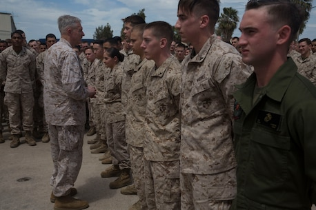 U.S. Marine Corps General Thomas D. Waldhauser, commander, U.S. Africa Command, present Marines and with the Special Purpose Marine Air-Ground Task Force-Crisis Response-Africa 19.2, Marine Forces Europe and Africa, coins at Naval Air Station Sigonella, Italy, May 9, 2019. General Waldhauser took time to speak with the SPMAGTAF about their and mission and role as a crisis response force. SPMAGTF-CR-AF is deployed to conduct crisis-response and theater-security operations in Africa and promote regional stability by conducting military-to-military training exercises throughout Europe and Africa. (U.S. Marine Corps photo by Staff Sgt. Mark E Morrow Jr.)