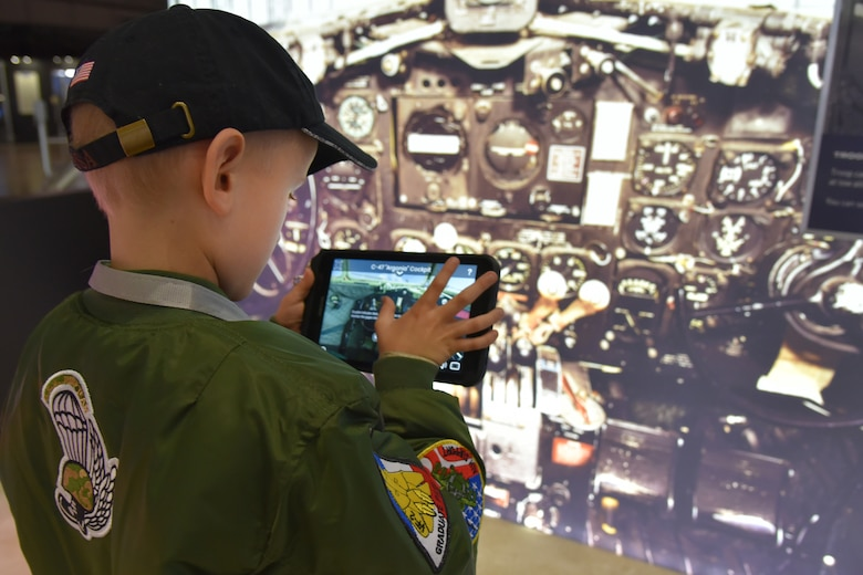 Visitors to the National Museum of the USAF in Dayton Ohio experience the augmented reality exhibit D-Day: Freedom From Above which engages visitors with a historically accurate journey back in time to Sainte-Mere-Eglise, the first French town to be liberated on June 6, 1944 during WWII. (U.S. Air Force photo by Ken LaRock)