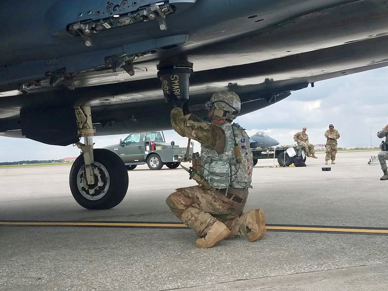 Tech. Sgt. Steven Wilson, 4th Logistics Readiness Squadron air transportation craftsman, performs hot-pit refueling of an F-15E during the Combat Support Wing capstone, May 9, 2019, at MacDill Air Force Base, Florida.