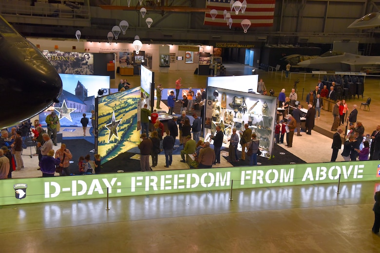 Crowds gather for the opening of the augmented reality exhibit D-Day: Freedom From Above at the National Museum of the USAF on May 13, 2019. The augmented reality exhibit D-Day: Freedom From Above engages visitors with a historically accurate journey back in time to Sainte-Mere-Eglise, the first French town to be liberated on June 6, 1944 during WWII. (U.S. Air Force photo by Ken LaRock)