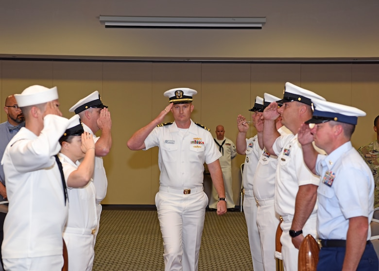 U.S. Navy Lt. Cmdr. J. Austin Maxwell, Center for Information Warfare Training detachment Goodfellow officer in charge, exchanges salutes with the seamen during the arrival of the official party at the event center on Goodfellow Air Force Base, Texas, May 9, 2019. The boatswains whistle was used to alert the crew of the arrival of the official party. (U.S. Air Force photo by Airman 1st Class Ethan Sherwood/Released)