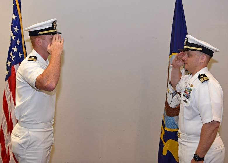 U.S. Navy Lt. Cmdr. J. Austin Maxwell, Center for Information Warfare Training detachment Goodfellow officer in charge, exchanges salutes with Lt. Cmdr. John Allen, departing CIWT detachment Goodfellow commanding officer, during the change of charge ceremony at the event center on Goodfellow Air Force Base, Texas, May 9, 2019. The change of charge ceremony is a time honored military tradition that signifies the visual transfer of authority. (U.S. Air Force photo by Airman 1st Class Ethan Sherwood/Released)