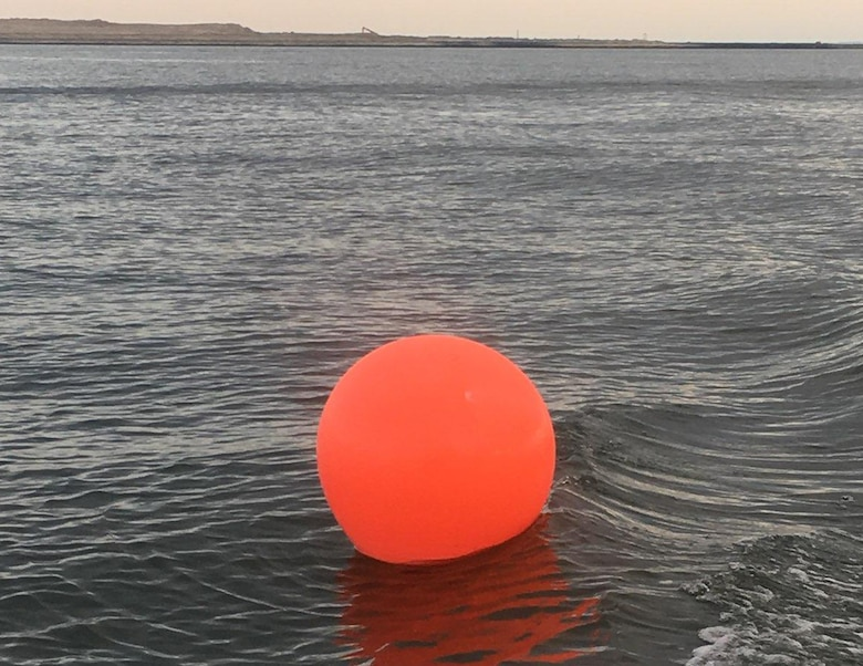 An orange ball buoy is shown to warn boaters of the navigation hazards located within the construction zone off of Poplar Island. This construction is part of Baltimore District's Poplar Island expansion project, which is a partnership with the Maryland Port Administration, to create an additional 575 acres of remote island habitat using clean material dredged from the Maryland Chesapeake Bay approach channels to the Port of Baltimore.