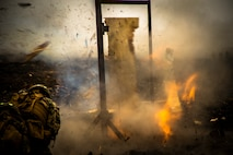 U.S. Marines with Combat Assault Company, attached to 2nd Battalion, 3rd Marine Regiment, conduct demolition breaching tactics during Exercise Bougainville II on Range 9, Pohakuloa Training Area, Hawaii, May 12, 2019. Bougainville II is the second phase of pre-deployment training conducted by the battalion in order to enhance unit cohesion and combat readiness.