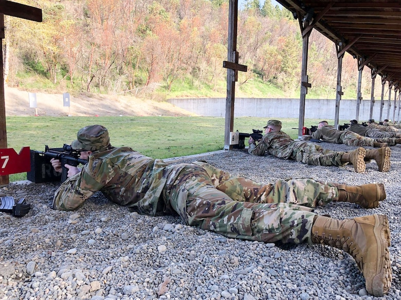 Members of the Washington Air National Guard's marksmanship team sight in their rifles at a Joint Base Lewis-McChord range April 4, 2019, prior to their departure to compete at the 2019 Winston P. Wilson Championship held at the Robinson Maneuver Training Center, Arkansas, April 7-10, 2019. (Courtesy photo by Staff Sgt. Shane Key)