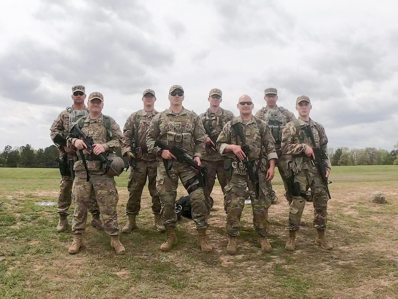 Members of the Washington Air National Guard's marksmanship team pose for a team picture during the 2019 Winston P. Wilson Championship at the Robinson Maneuver Training Center, Arkansas, April 10, 2019.  Pictured in the first row (from left to right) are: Master Sgt. Eric Poe, 225th Support Squadron; Staff Sgt. Shane Key, 225th SS; Master Sgt. Ryan Rathbun, 194th Medical Group; Senior Airman Richard Delinsky 194th Comptroller Flight. 