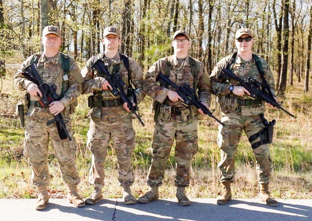 The Western Air Defense Sector marksmanship team poses for a team picture during the 2019 Winston P. Wilson Championship, Robinson Maneuver Training Center, Arkansas, April 10, 2019.  Pictured from left to right: Master Sgt. Eric Poe, 225th Support Squadron; Master Sgt. Shay Brockman, 225th Air Defense Squadron; Tech. Sgt. Cameron Riedl, 225th ADS; and Staff Sgt. Shane Key, 225th SS.  (Courtesy photo by Staff Sgt. Shane Key)
