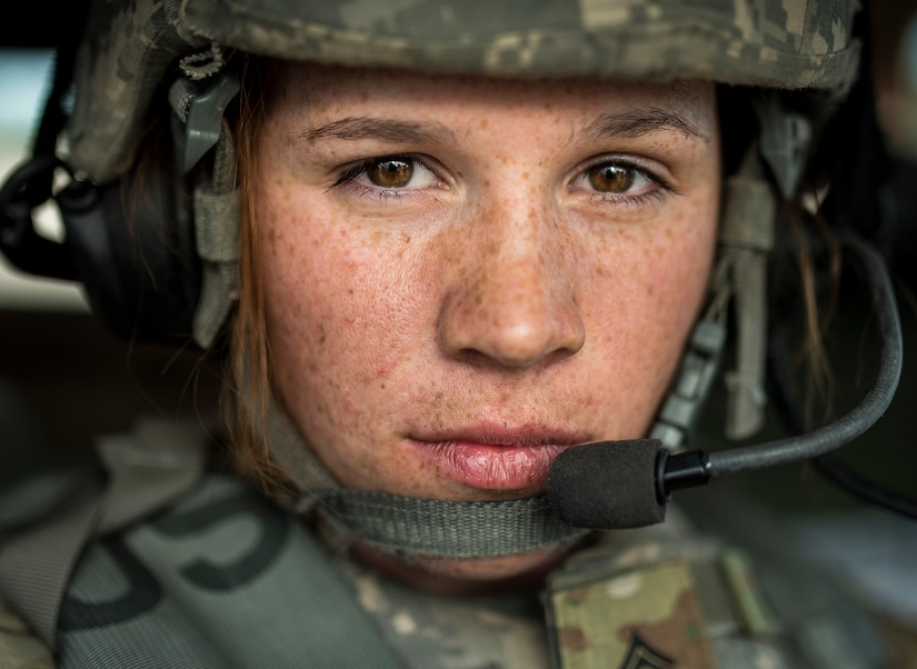 Sergeant Brooke Grether, U.S. Army Reserve military police Soldier and gunnery crew truck commander with 603rd MP Company, out of Belton, Missouri, poses for portrait after finishing gunnery lane at Fort Riley, Kansas, May 18, 2018 (U.S. Army Reserve/Michel Sauret)