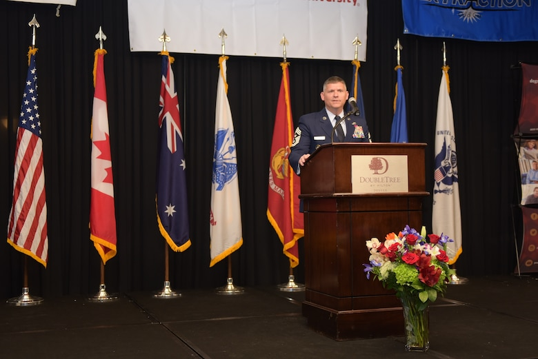 Chief Master Sgt. Patrick McMahon, command chief of U.S. Strategic Command, speaks at the Armed Forces Recognition Luncheon at the Doubletree by Hilton in Denver, Colorado, May 10, 2019.