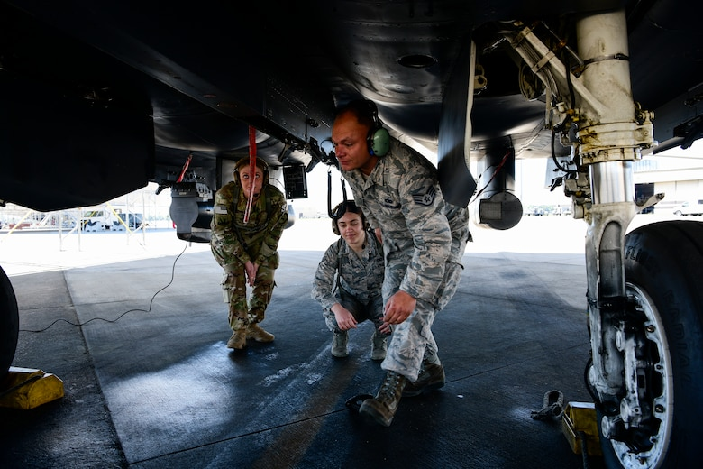 Staff Sgt. Joshua Jennette, 336th Aircraft Maintenance Unit avionics lead, instructs two defenders from the 4th Security Forces Squadron on different parts of the F-15E Strike Eagle during the Combat Support Wing exercise, April 17, 2019, at Seymour Johnson Air Force Base, North Carolina. 110 Airmen from 15 bases participated in the exercise. (U.S. Air Force photo by Senior Airman Kenneth Boyton)