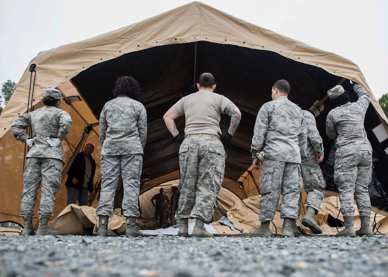 Global Response Force team members assess their tent, May 6, 2019 at Joint Base Langley-Eustis, Virginia.
