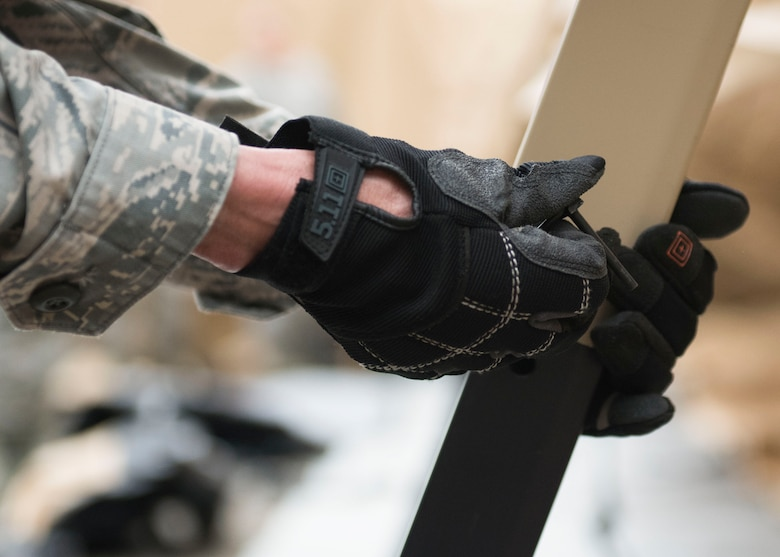 An Airman secures a tent post, May 6, 2019 at Joint Base Langley-Eustis, Virginia.